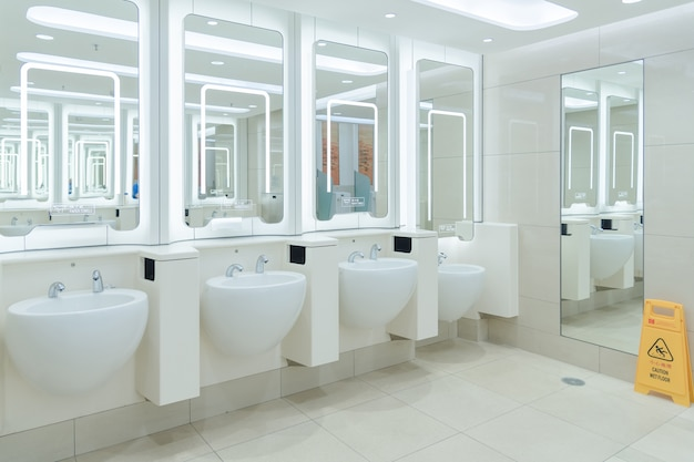 Clean public men toilet in modern international airport for service all passengers