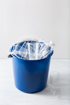 Clean recyclable plastic bottles, containers, cups in garbage bin. waste management plastic reuse