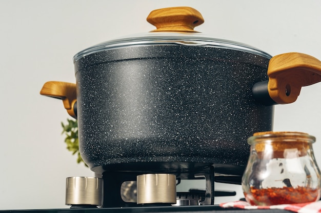 Clean saucepan on a gas stove in kitchen