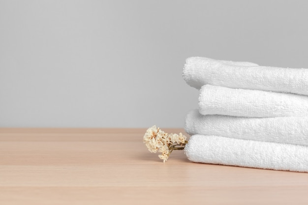 Clean soft towels on color background