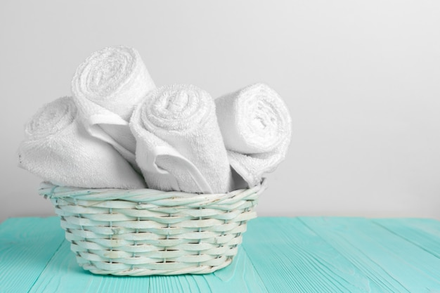 Clean soft towels on wooden table