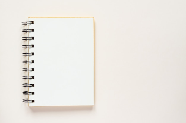 Clean spiral note book for notes and messages. minimal business flat lay