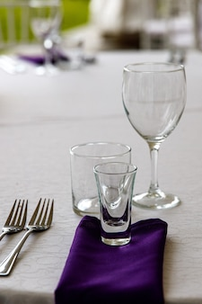 Clean tableware on the festive table.