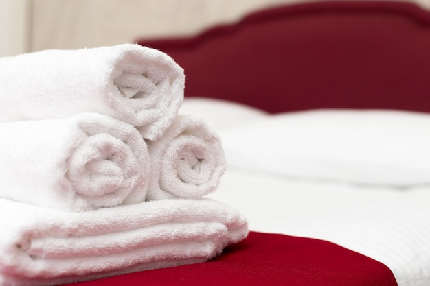 Clean towels on bed at hotel room