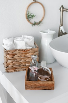 Clean towels, soap and a bottle of oil on a wooden table in the room. toilet articles the hotel.