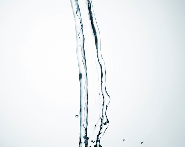 Clean water flowing on light background