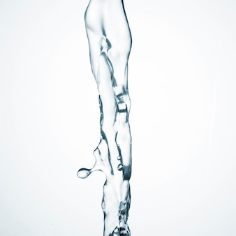 Clean water flowing on white background