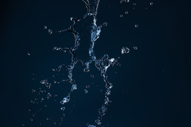 Clean water jet falling on an empty black background