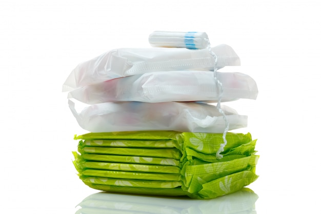 Clean white cotton tampon and pads isolated on a white.