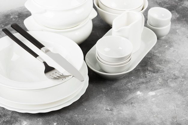 Clean white tableware on a gray background. copy space