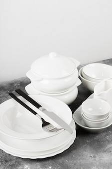Clean white tableware on a gray background