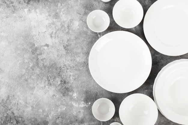 Clean white tableware on a gray background.