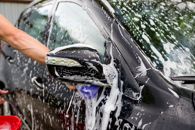 Cleaning automobile with high pressure water
