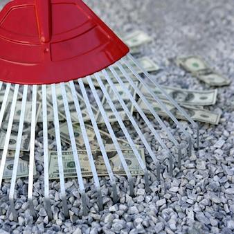 Cleaning black dolar money with rake, metaphor