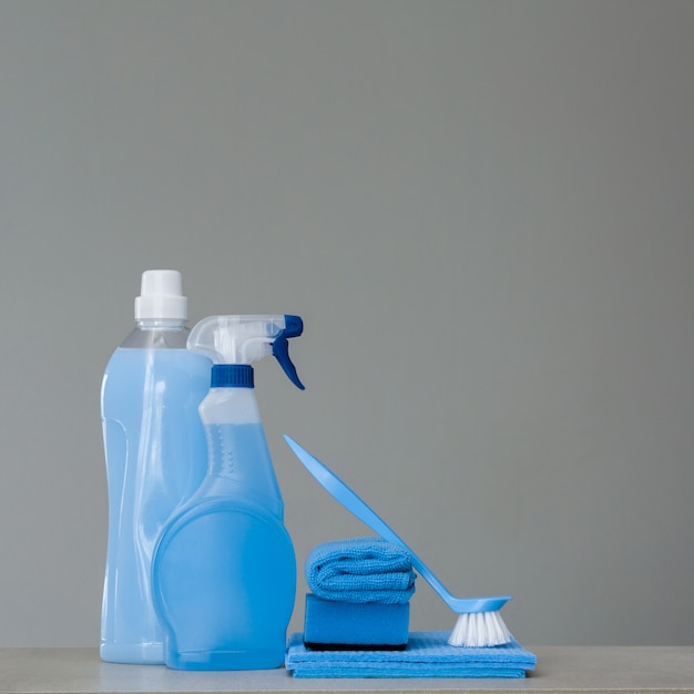 Cleaning blue set on grey background. cleaning tools and products