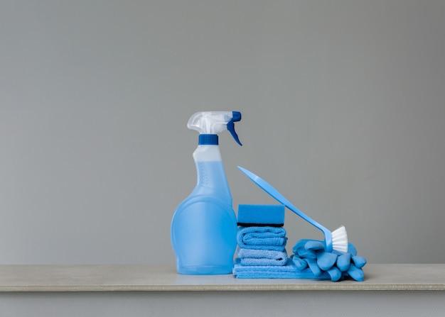 Cleaning blue spray bottle with plastic dispenser, sponge, scrubbing brush