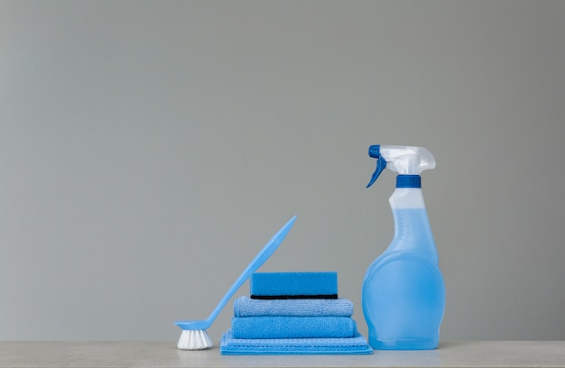 Cleaning blue spray bottle with plastic dispenser, sponge