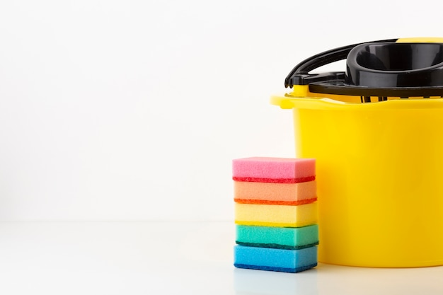 Cleaning bucket with colorful sponges
