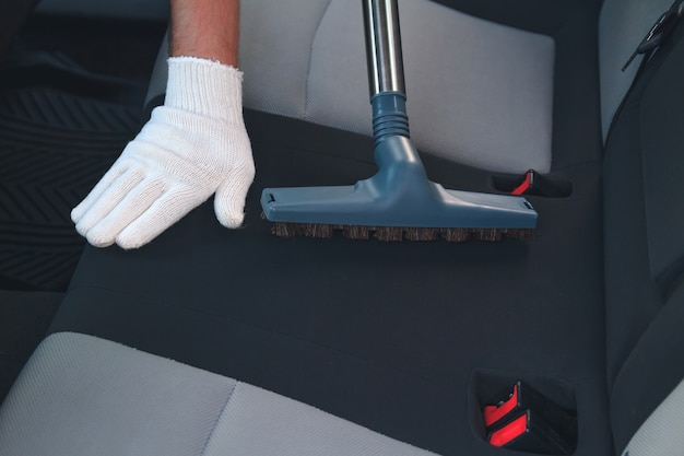 Cleaning the car interior with a vacuum cleaner