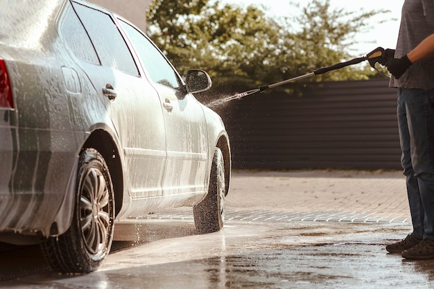Cleaning car using active foam selfservice car wash