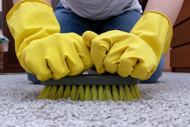 Cleaning carpet with a brush