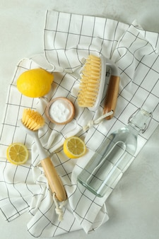 Cleaning concept with eco friendly cleaning tools on white textured table