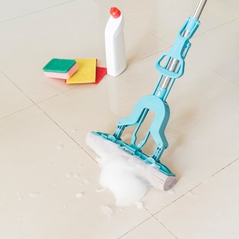 Cleaning concept with plastic bottle and mop