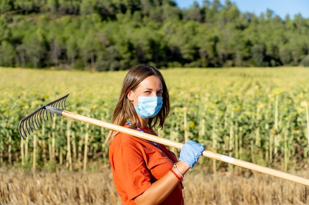 Cleaning employees with masks posing