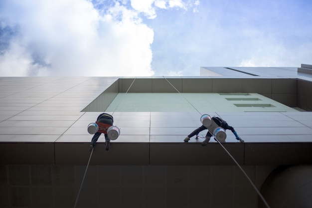 Cleaning exterior building with danger service