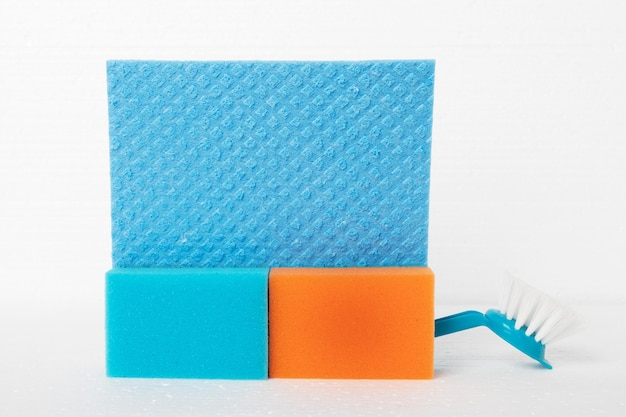 Cleaning furniture, carpets, floor coverings. sponges, rags, brushes on a white background
