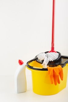 Cleaning glove in bucket with copy space