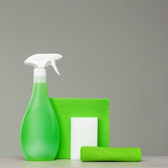 Cleaning green spray bottle with plastic dispenserools.