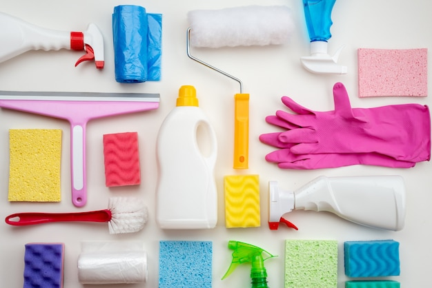 Cleaning items are laid out on a white surface