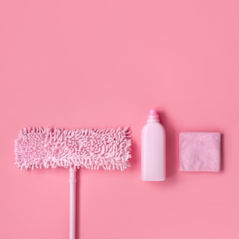 Cleaning kit in the house pink on a pink background