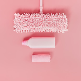 Cleaning kit in the house pink on a pink background.