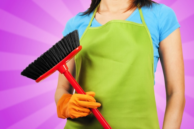 Cleaning maid with a broom housework