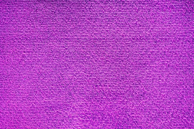 Cleaning microfiber pattern. purple polyester microfibre texture. synthetic fiber material cleaning cloth for dust or kitchen top view closeup