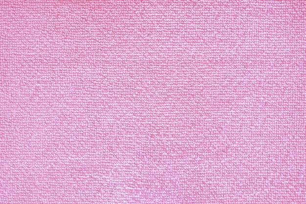 극세사 청소. 핑크 폴리 에스터 마이크로 화이버 질감 배경입니다. 합성 섬유 소재 청소
