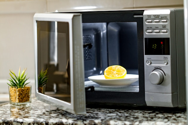 Cleaning a microwave using lemon