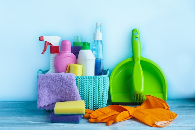 Cleaning products and household chemicals in a plastic basket