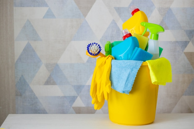 Cleaning products and materials in a yellow bucket - isolated.cleaning bucket