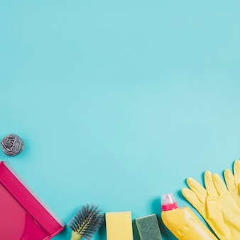 Cleaning products on turquoise background