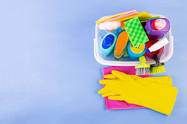 Cleaning service concept. colorful cleaning set for different surfaces in kitchen, bathroom and other rooms. top view