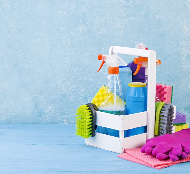 Cleaning service concept. colorful cleaning set for different surfaces in kitchen, bathroom and other rooms.