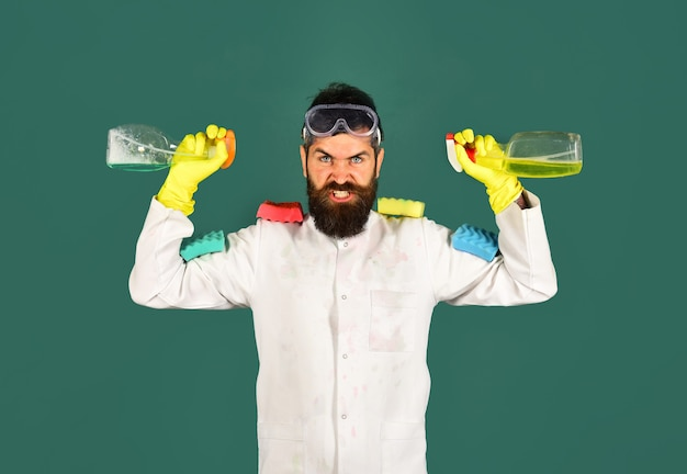 Cleaning service. man with cleaning products. cleaning tools. angry man with sponges. advertising. desinfection.