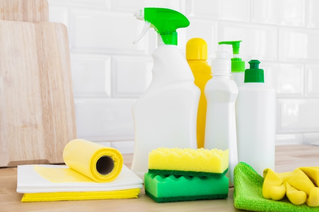 Cleaning set for different surfaces. cleaning products or home cleaning concept.
