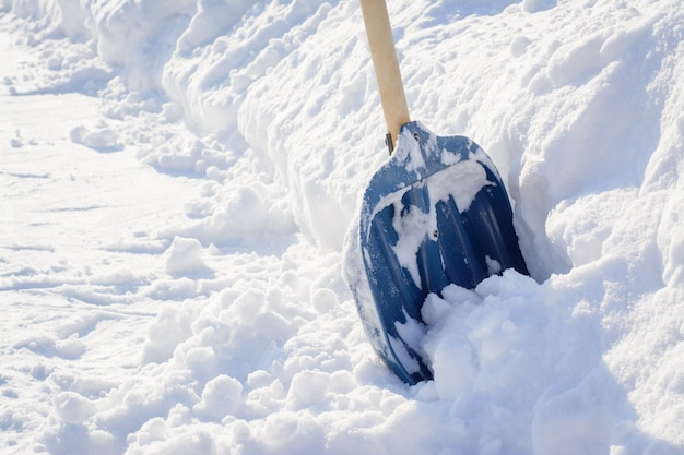 Cleaning snow after a snowstorm in winter