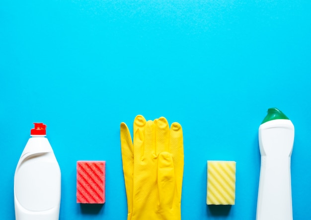 Cleaning supplies on blue table