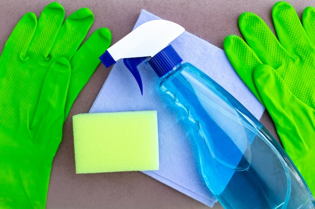 Cleaning supplies and cleaning products for washing furniture in room at home. housekeeping and household chores