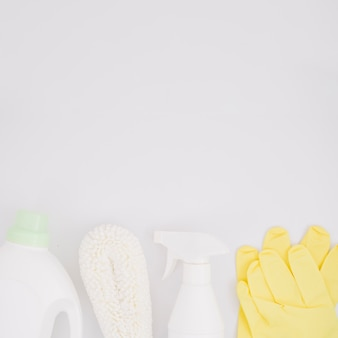 Cleaning supplies on white backdrop